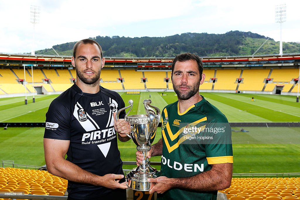 Captains Cameron Smith of the Kangaroos and Simon Mannering of the Kiwis pose with the Four Nations Cup during a joint New Zealand Kiwis and Australian Kangaroos Four Nations Final joint press conference at Westpac Stadium on November 14, 2014 in Wellington, New Zealand.