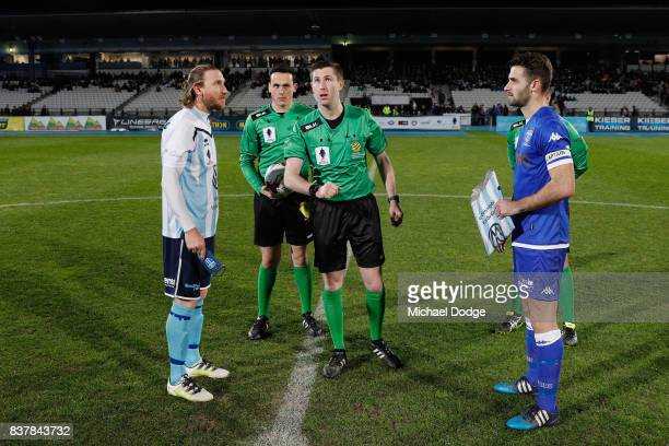 Captains Daryl Platten of Sorrento and Brad Norton of South Melbourne watch the coin toss during the FFA Cup round of 16 match between between South...