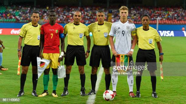 Captains Fandje Toure of Guinea and JannFiete Arp of Germany pose for a photo with the match officials ahead of the FIFA U17 World Cup India 2017...