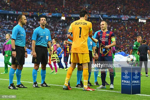 Captains Gianluigi Buffon of Juventus and Andres Iniesta of Barcelona shake hands prior to the UEFA Champions League Final between Juventus and FC...