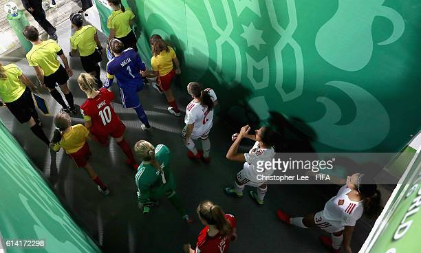 Captains Janina Minge of Germany and Noelia Ramos of Spain lead their teams out onto the pitch during the FIFA U17 Women's World Cup Jordan 2016...