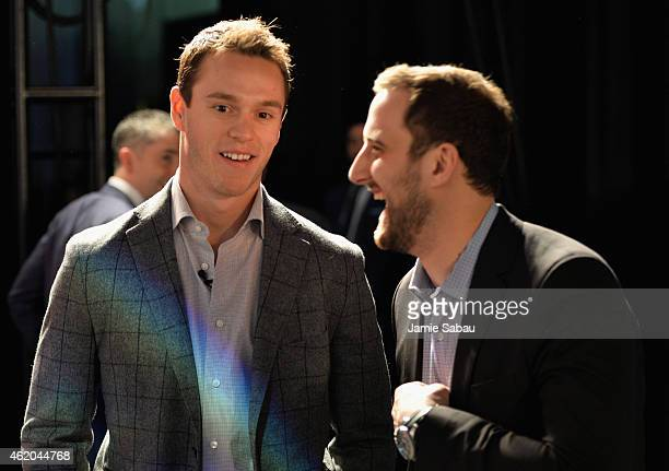 Captains Jonathan Toews of the Chicago Blackhawks and Nick Foligno of the Columbus Blue Jackets wait backstage before the NHL AllStar Fantasy Draft...