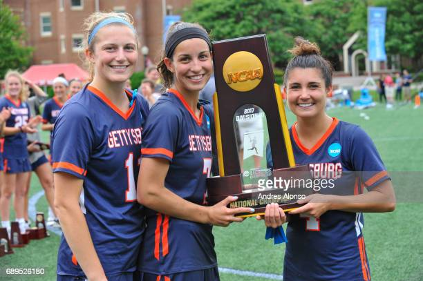 Captains Maccauley Mikes 11 Emma Christie and Katelyn Neillands of Gettysburg College with the Division III Women's Lacrosse Championship trophy at...