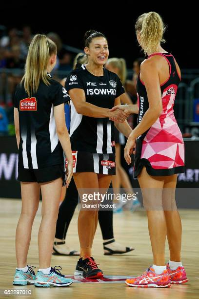 Captains Madi Robinson of the Magpies and Erin Bell of the Thunderbirds shake hands before the coin toss prior to the round four Super Netball match...