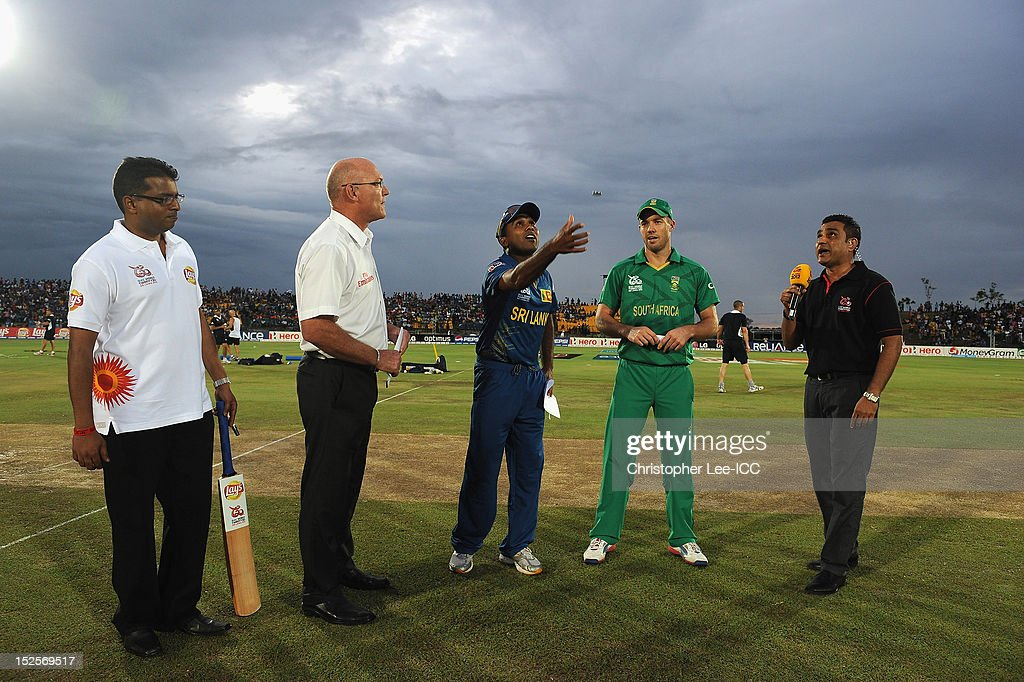 Captains <a gi-track='captionPersonalityLinkClicked' href=/galleries/search?phrase=Mahela+Jayawardene&family=editorial&specificpeople=213707 ng-click='$event.stopPropagation()'>Mahela Jayawardene</a> of Sri Lanka and AB De Villiers of South Africa toss the coin during the ICC World Twenty20 2012 Group C match between Sri Lanka and South Africa at Mahinda Rajapaksa International Cricket Stadium on September 22, 2012 in Hambantota, Sri Lanka.