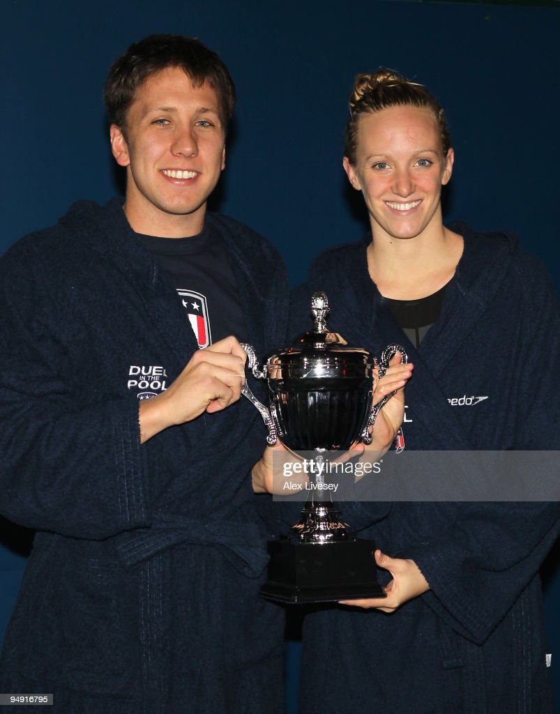 Captains Mark Gangloff and Dana Vollmer pose with the trophy at the end of day two of the Duel in the Pool between the United States and the E-Stars, a European team, at The Manchester Aquatics Centre on December 19, 2009 in Manchester, England.