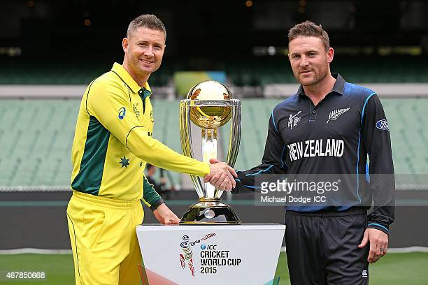 Captains Michael Clarke of Australia and Brendon McCullum of New Zealand pose with the World Cup trophy during the 2015 ICC Cricket World Cup Final...