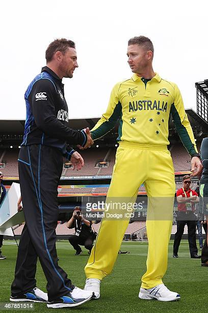 Captains Michael Clarke of Australia and Brendon McCullum of New Zealand shake hands after posing with the World Cup trophy during the 2015 ICC...