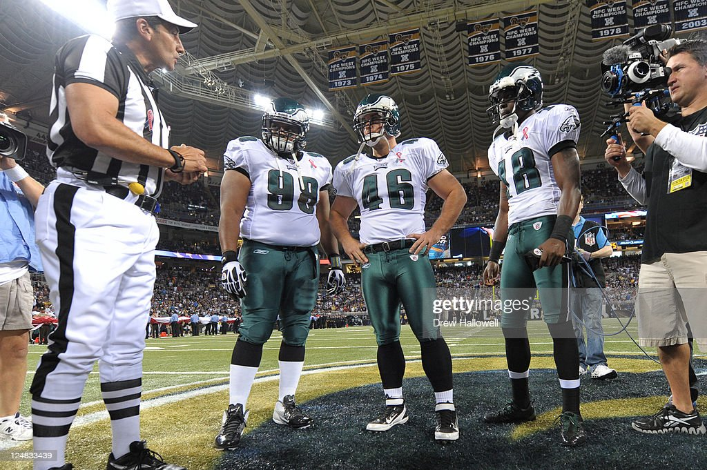 Captains Mike Patterson Jon Dorenbos and Jeremy Maclin of the Philadelphia Eagles wait for the coin toss during the game against the St Louis Rams at...