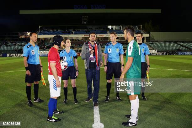 Captains Nicholas Stavroulakis of Sydney United 58 FC and Jamie Carroll of FNQ Heat take part in the coin toss prior to the FFA Cup round of 32 match...