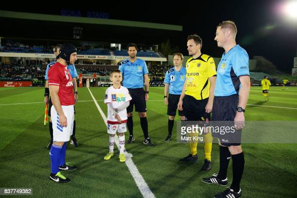 Captains Nicholas Stavroulakis of Sydney United 58 FC and Luke Byles of Heidleberg United take part in the coin toss during the FFA Cup round of 16...