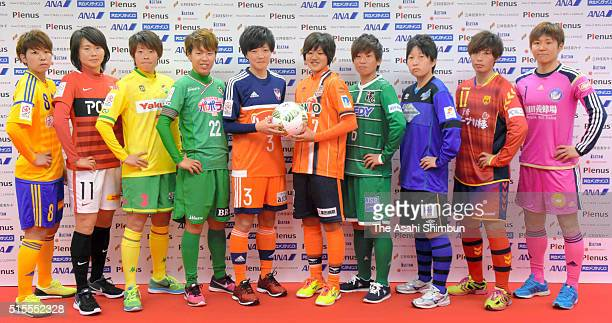Captains of the Nadeshiko League teams pose for photographs during a press conference on March 14 2016 in Tokyo Japan
