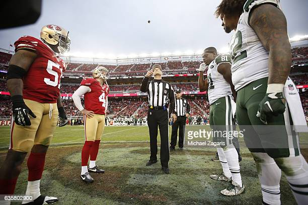 Captains of the San Francisco 49ers and the New York Jets meet at midfield for the coin flip prior to the start of overtime during the game at Levi...