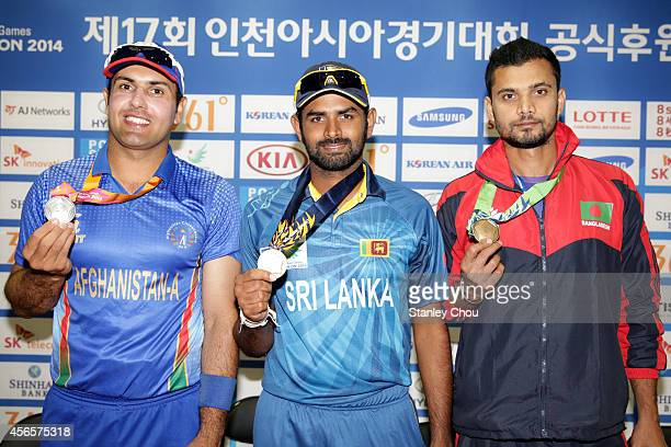 Captains of the team Mohammad Nabi of Afganistan Thirmanna Hettie of Sri Langa and Mashrafe Mortaza of Bangladesh shows of their medals during the...