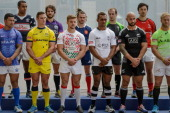 Captains of the teams competing in the upcoming Hong Kong Rugby Sevens tournament pose in Hong Kong on March 26 2014 The 2014 edition of the Hong...