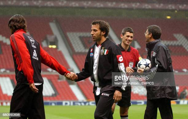 Captains Paolo Maldini of AC Milan and Alessandro Del Piero of Juventus shake hands after a ceremony to officially hand over the UEFA Champions...