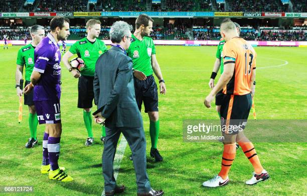 Captains Richard Garcia of the Glory and Jade North of the Roar during the coin toss during the round 26 ALeague match between the Perth Glory and...
