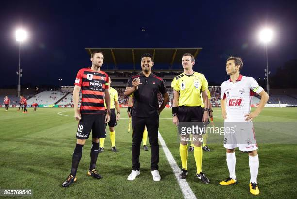 Captains Robbie Cornthwaite of the Wanderers and Isaias of United take part in the coin toss during the FFA Cup Semi Final match between the Western...