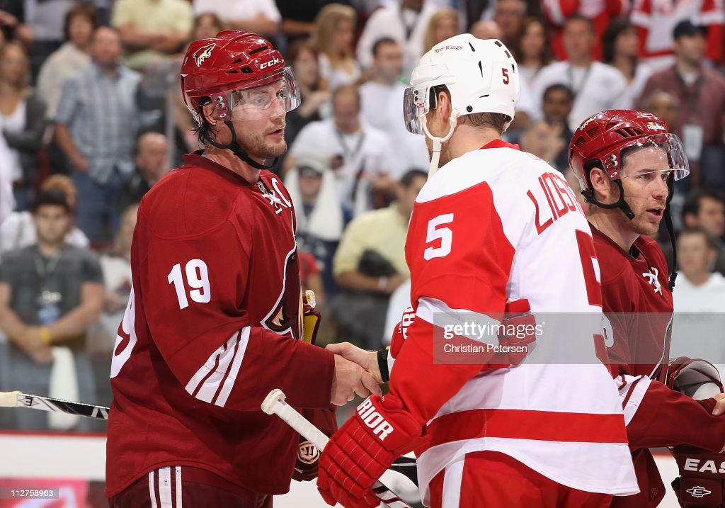 Captains Shane Doan of the Phoenix Coyotes and Nicklas Lidstrom of the Detroit Red Wings shake hands following Game Four of the Western Conference...