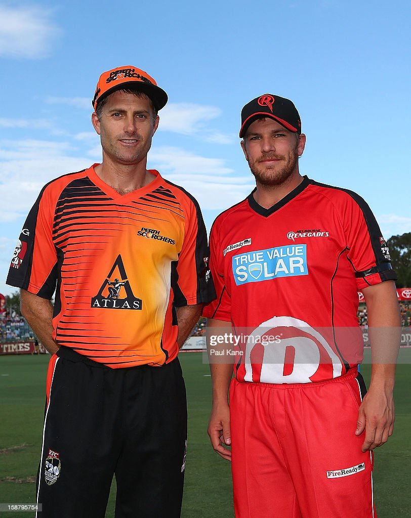 Captains Simon Katich of the Scorchers and Aaron Finch of the Renegades pose after the coin toss during the Big Bash League match between the Perth Scorchers and the Melbourne Renegades at WACA on December 29, 2012 in Perth, Australia.