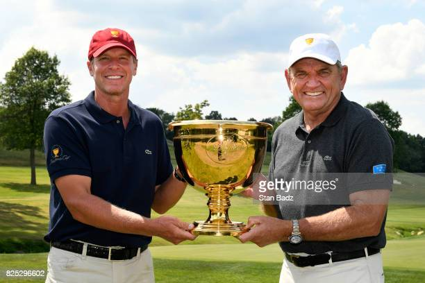 Captains Steve Stricker of the United States Presidents Cup Team and Nick Price of the International Team pose with the trophy prior to the World...