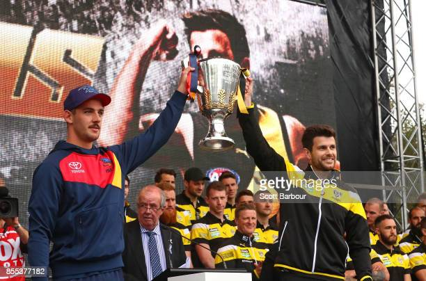Captains Taylor Walker of the Crows and Trent Cotchin of the Tigers show the Premiership Cup to the crowd during the 2017 AFL Grand Final Parade on...