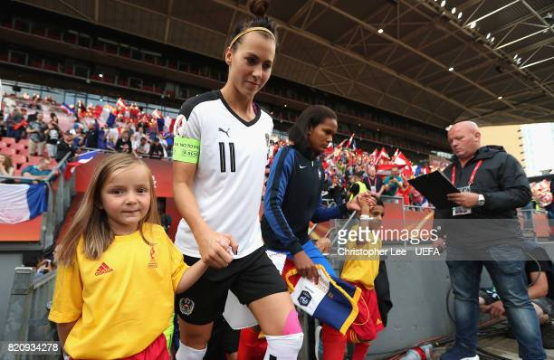 Captains Viktoria Schnaderbeck of Austria and Wendie Renard of France leads their teams out onto the pitch during the UEFA Women's Euro 2017 Group C...
