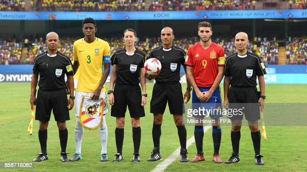 Captains Vitao of Brazil and Abel Ruiz pose for a photo with match officials ahead of the FIFA U17 World Cup India 2017 group D match between Brazil...