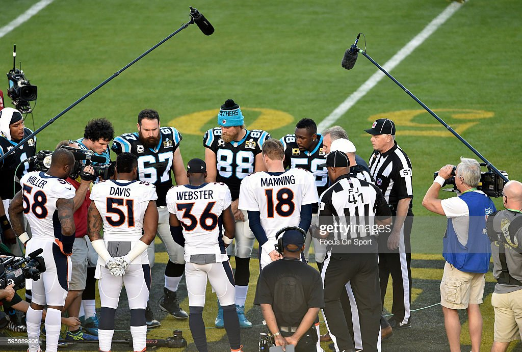 Captains Von Miller Todd Davis Kayvon Webster and Peyton Manning of the Denver Broncos meet at the 50 yard line with captains Cam Newton Luke Kuechly...