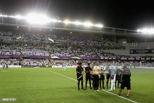 Captains Waleed Salem of Al Ain and Aleksandar Kolarov of Manchester City shake hands after the coin toss ahead of the friendly match between Al Ain...