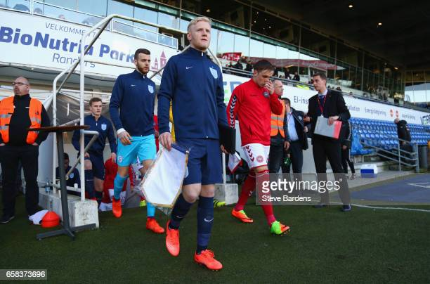 Captains Will Hughes of England and Lasse Vigen Christensen of Denmark lead out the teams prior to the U21 international friendly match between...
