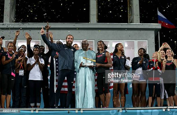Captains Will Leer and Chanelle Price of the United States are awarded the golden baton from IAAF President Lamine Diack following the conclusion of...