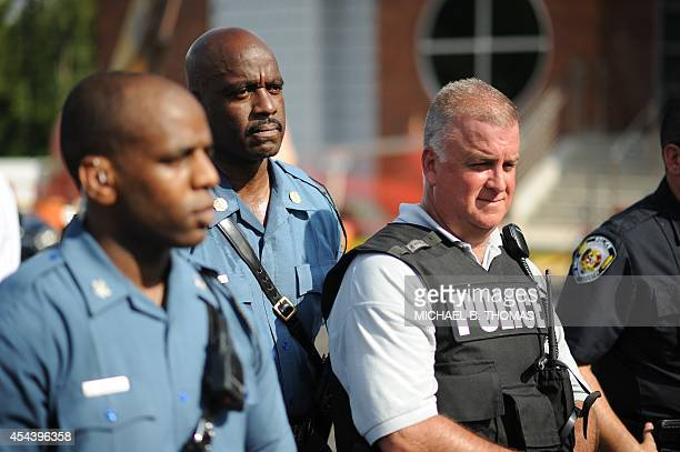 Captan Ronald Johnson of the Missouri Highway Patrol listens to the concerns of the protestors during the peaceful National March on Ferguson outside...