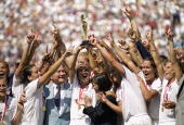 Captian Carla Overbeck of the US Women's Soccer Team raises the World Cup Trophy as the team celebrates their victory over Team China in the...