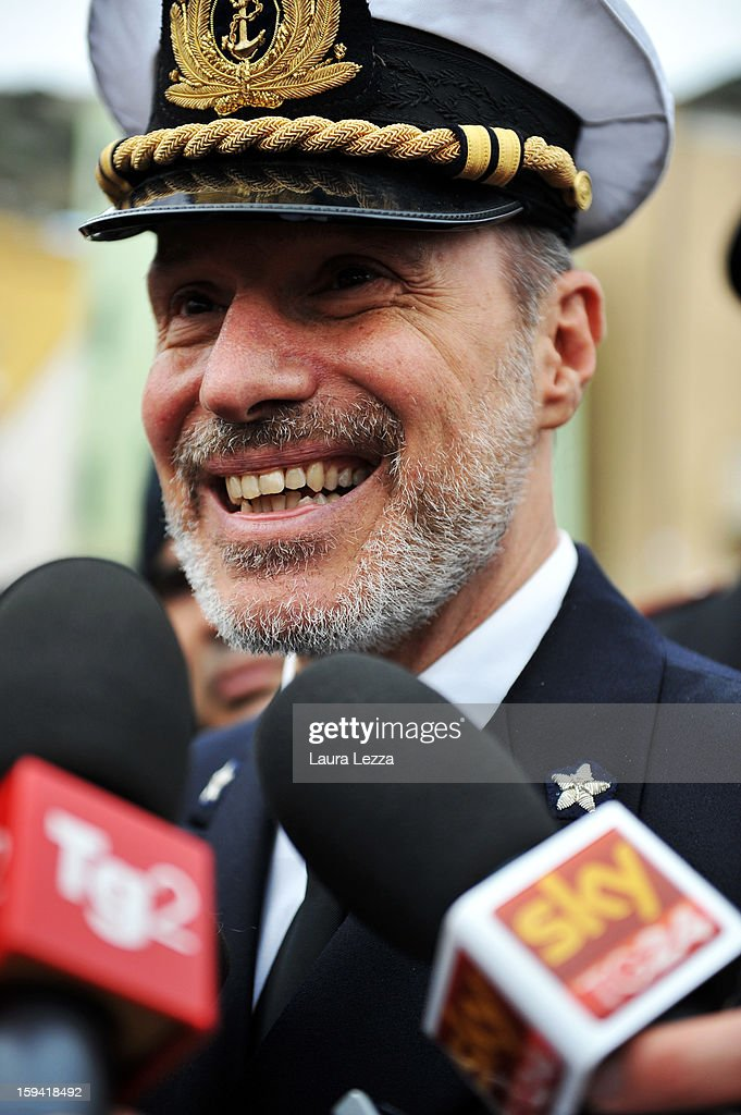 Captian Gregorio De Falco speaks to the media during a commemoration of the victims of the sunken Costa Concordia on January 13, 2013 in Giglio Porto, Italy. A year after the sinking of the ship Costa Concordia, relatives of the victims, survivors, island residents, law enforcement and institutions gathered to mark the first anniversary and commemorate the dead. More than four thousand people were on board when the ship hit a rock off the Tuscan coast, killing 32 and leaving two people missing.