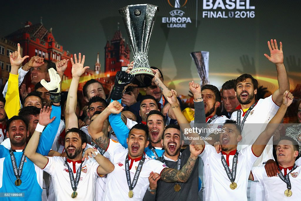 Captian Jose Antonio Reyes (C) of Sevilla lifts the Europa League trophy as players celebrate at the award ceremoy after the UEFA Europa League Final match between Liverpool and Sevilla at St. Jakob-Park on May 18, 2016 in Basel, Switzerland.