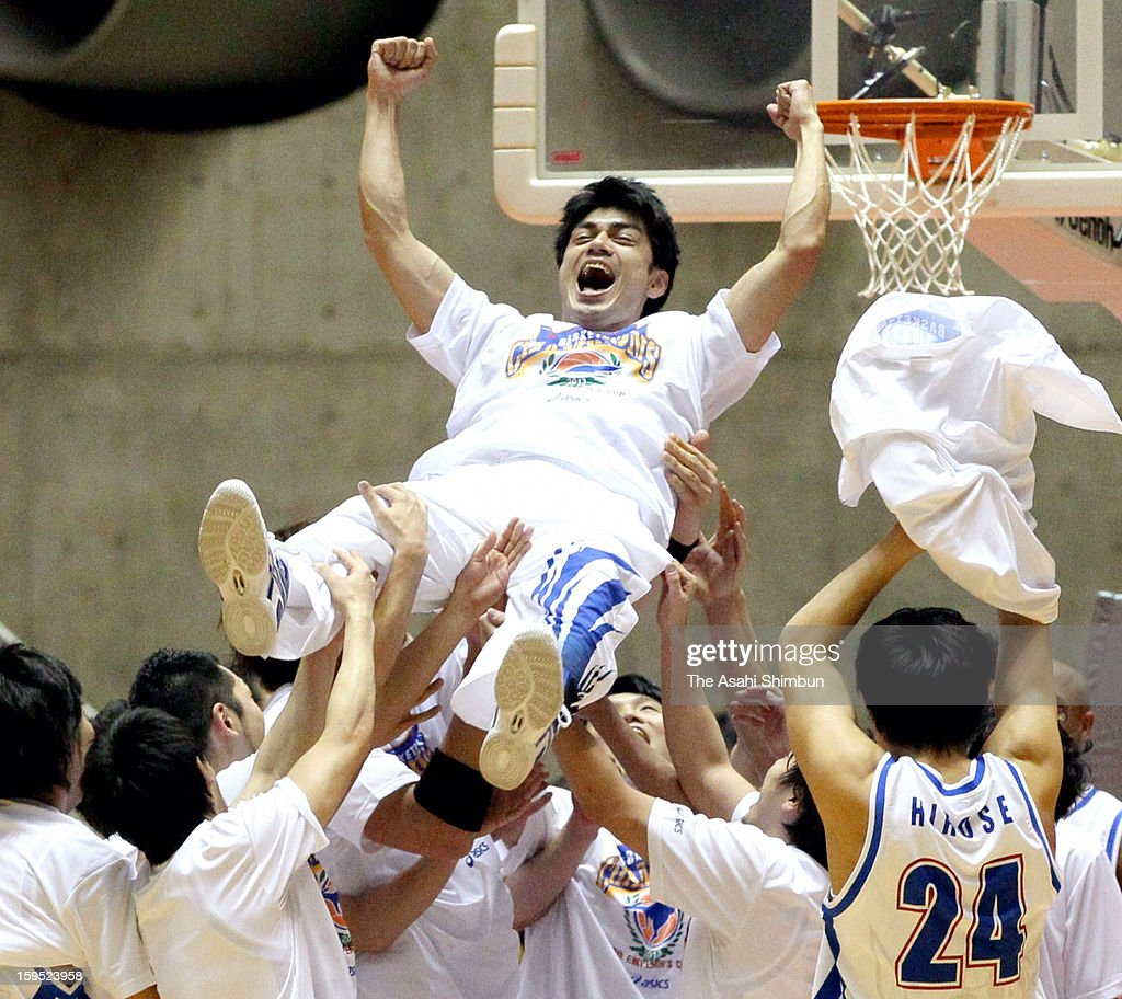 Captian Makoto Nagayama of Panasonic Trians is thrown into the air after winning the 88th Emperor's Cup All Japan Men's Basketball Championship between Panasonic Trians and Aisin Seahorses at Yoyogi national Gymnasium on January 14, 2013 in Tokyo, Japan. Panasonic, already announced to be fold the basketball team due to the slumping business won the last championship for them.