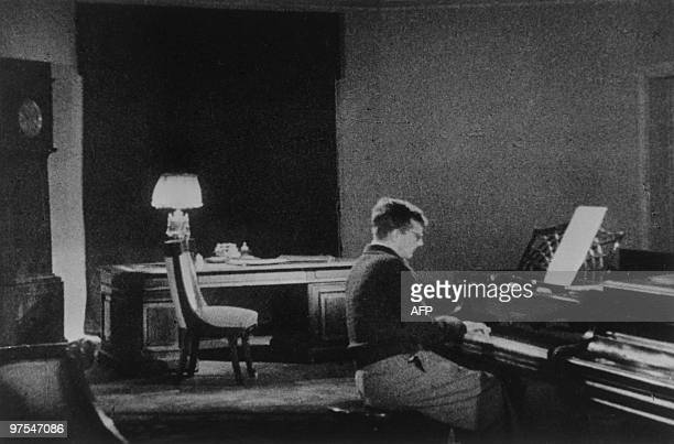 Caption of this picture released by Soviet official press agency Tass reads ''Dmitri Dmitriyevich Shostakovich working over his famous Seventh...