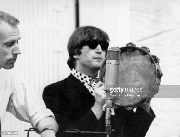 Caption reads 'John on tambourine Beatle recording sessions mainspring of success are strictly private' John Lennon formed the Beatles in 1960 with...