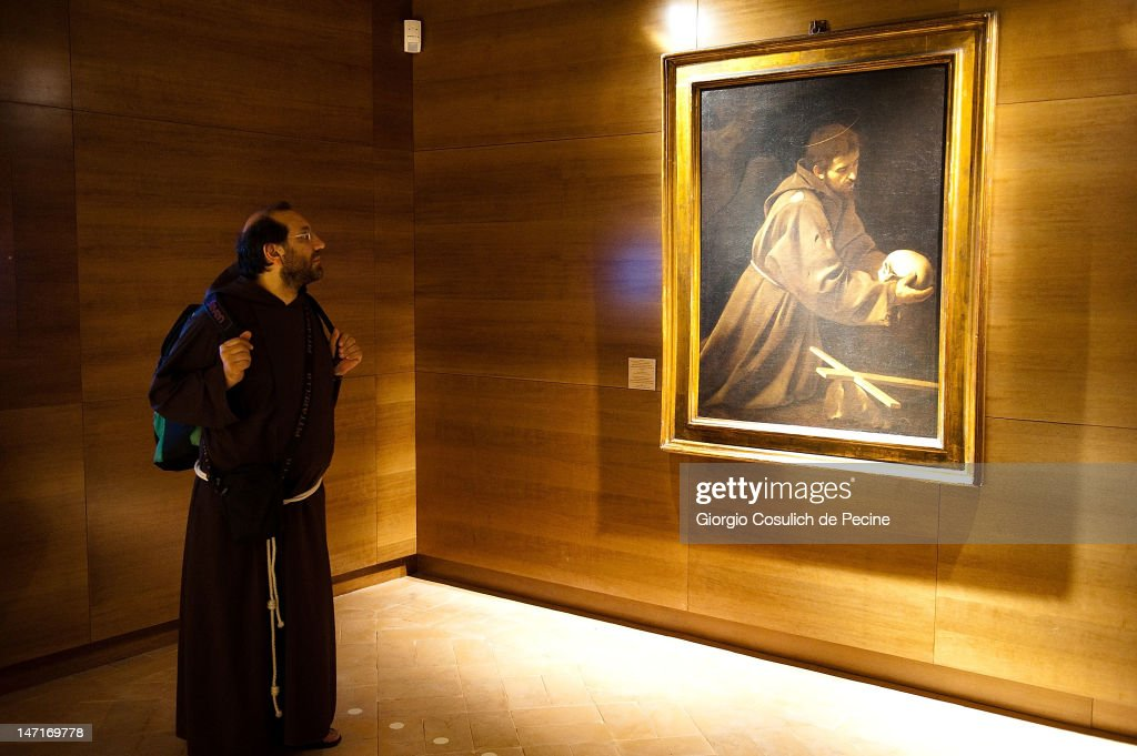 A Capuchin monk observes the painting by Caravaggio entitled 'St. Francis in Meditation' during the opening of the museum in the Capuchin convent of the Immaculate Conception of the Blessed Virgin Mary on June 26, 2012 in Rome, Italy. The monastery, which was first used by Capuchin monks and nuns in 1626, has become a destination for tourists from all over the world who visit an ossuary in the crypt which contains the skeletal remains of 3,700 monks.