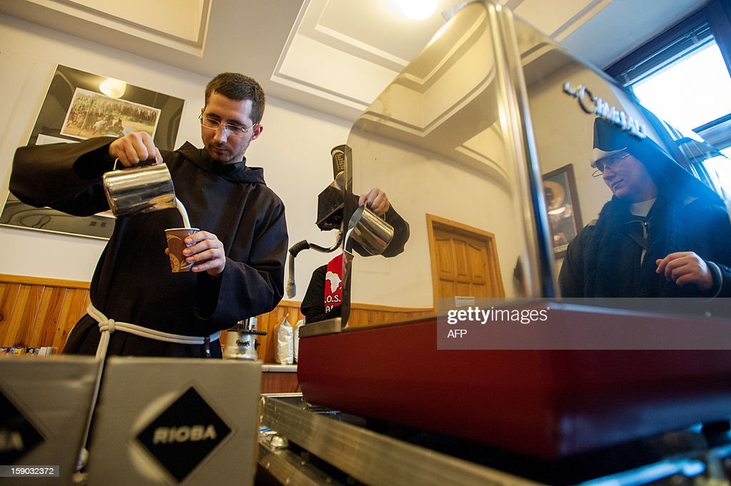 A Capuchin monk prepares a coffee in a cafe in Krakow, Poland, on January 6, 2013.Capuchin friars in Poland are using the popular cappuccino-style coffee named after their Roman Catholic order to raise funds for aid projects in Africa.