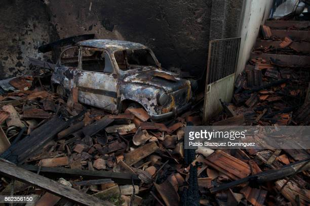 A car and a house are burnt near Penacova on October 17 2017 in Coimbra region Portugal At least 37 people have died in fires in Portugal and 4...