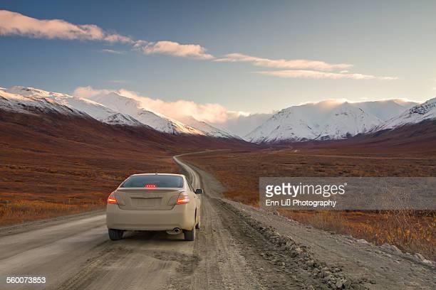 Car and dirt road