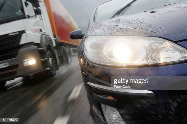 car and lorry on motorway in the rain