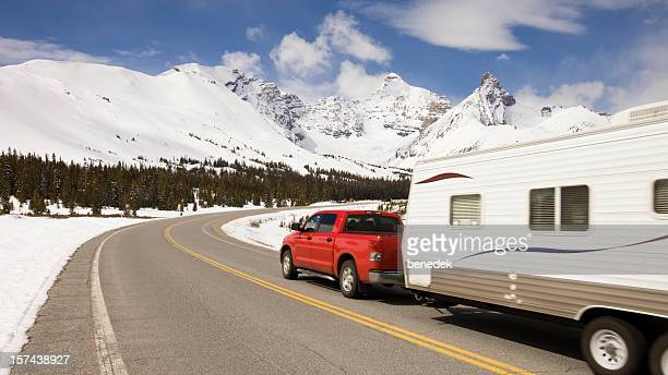 Car and travel trailer in the mountains
