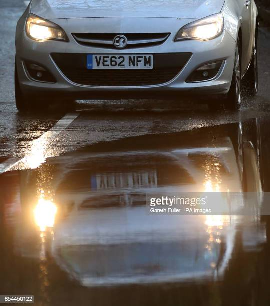 A car approaches a flooded road near Yalding Kent as more heavy rain sweeps across the country Picture date Monday December 30 2013 See PA story...