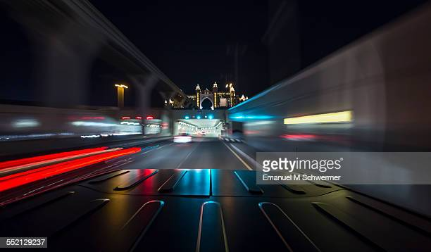 car approaches a tunnel during night
