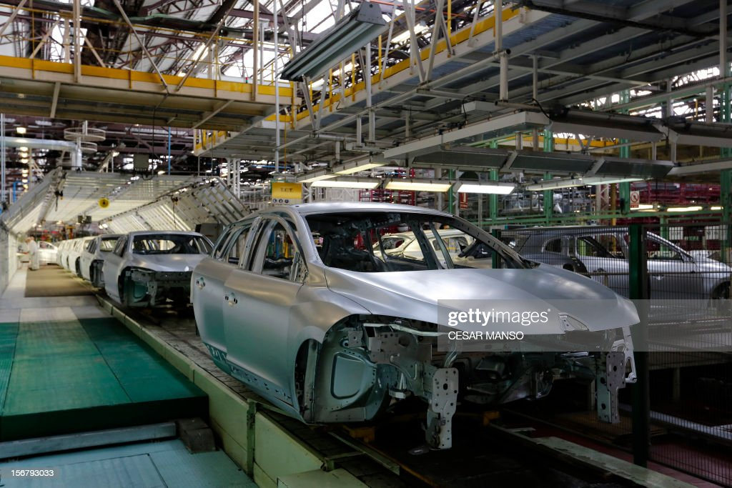 Car are pictured at the Villamuriel Renault factory in northern Spain on November 21, 2012. French car maker Renault plans to create 1,300 jobs at its factories in recession-hit Spain, Spanish Prime Minister Mariano Rajoy said. The French giant, which employs 10,000 people at four sites in Spain, signed a deal on working conditions with Spanish labour unions last week but is still negotiating terms with workers in France as it seeks to be more competitive.