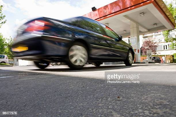 Car arriving at gas station