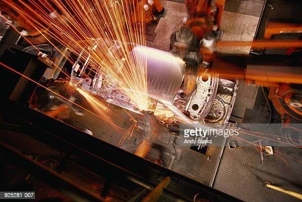Car assembly line,overhead view of robotic welding on car body